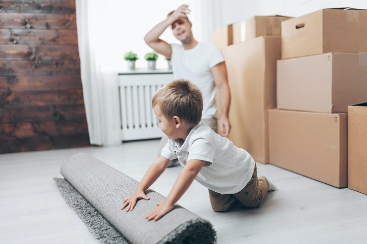 Moving concept, Father and son moving to a new home