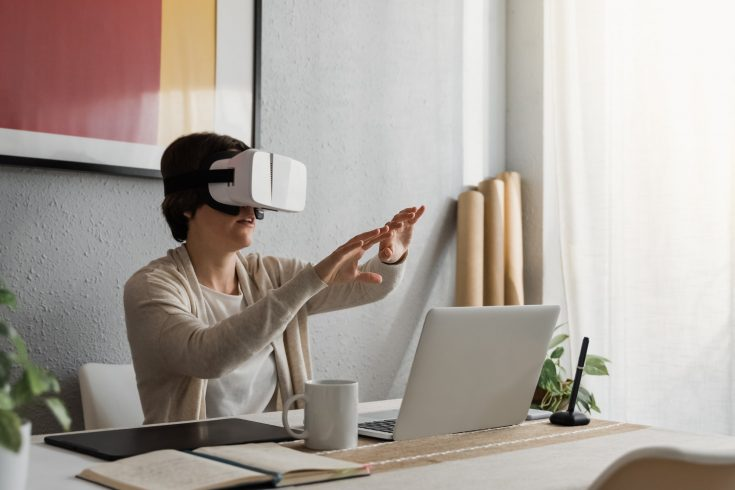 Young architect woman using vr headset for real estate virtual reality tour development
